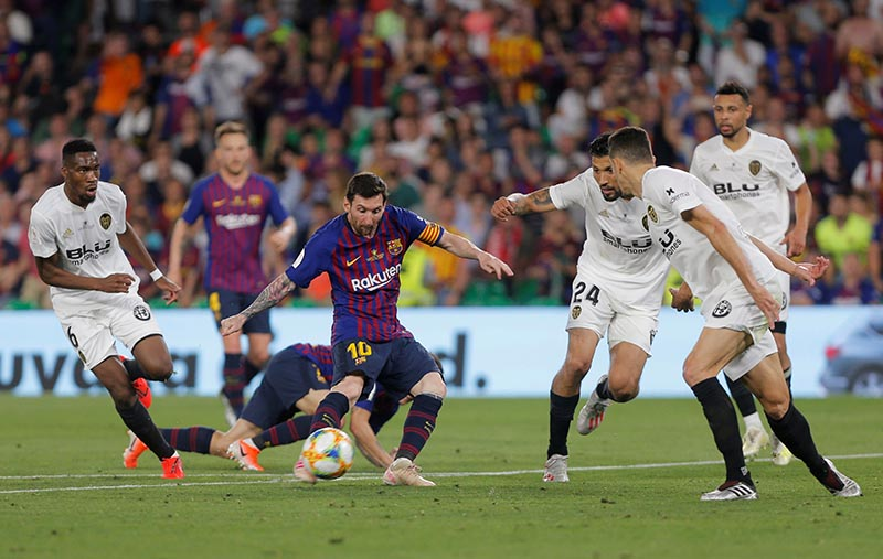 Barcelona's Lionel Messi in action with Valencia's Ezequiel Garay during the Copa del Rey Final between FC Barcelona and Valencia, at Estadio Benito Villamarin, in Seville, Spain, on May 25, 2019. Photo: Reuters