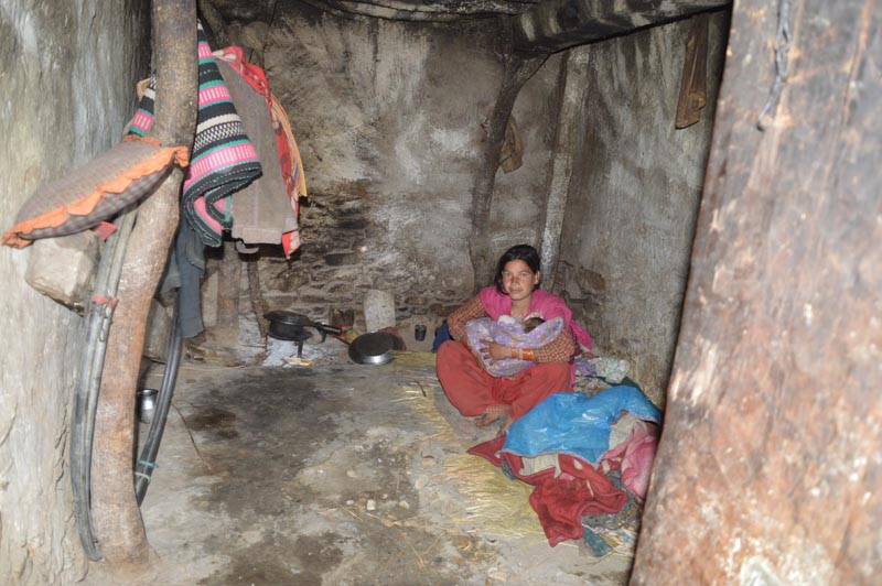 A mother with her newly born child in a cow shed in Swami Kartik Khapar Rural Municipality of Bajhang district on Monday, May 13, 2019. Photo: Prakash Singh