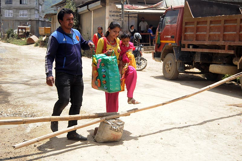 People forced to walk to their destinations as locals have halted traffic on the Dholahiti-Chapagaun road segment, in Lalitpur, on Monday, May 13, 2019. Photo: Balkrishna Thapa Chhetri/THT