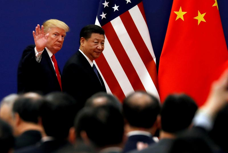 FILE: US President Donald Trump and China's President Xi Jinping meet business leaders at the Great Hall of the People in Beijing, China, November 9, 2017. Photo: Reuters/file
