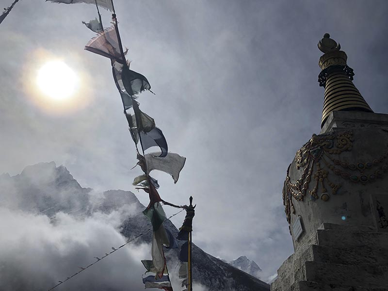 This photo depicts one of the many prayer flags and Buddhist monuments that exist along the Everest Base Camp Trek in Nepal's Sagarmatha National Park, as taken on  April 9th, 2019. Photo: Molly Sprayregen via AP