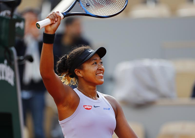 Japan's Naomi Osaka greets the crowd after winning her first round match against Slovakia's Anna Karolina Schmiedlova during the French Open, at Roland Garros, in Paris, France, at May 28, 2019. Photo: Reuters