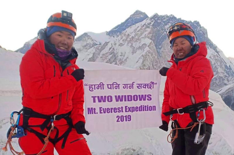 FILE - Furdiki Sherpa and Nima Doma Sherpa holding a banner atop Mt Everest. Photo: Two Widows Expedition via THT