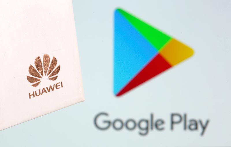 Huawei logo is seen in front of displayed Google Play logo in this illustration taken May 20, 2019. Photo: Reuters