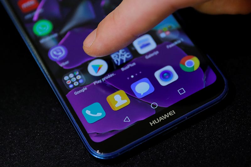 A man points a finger to the Google Play app logo on his Huawei smartphone in this illustration picture  May 20, 2019. Photo: Reuters