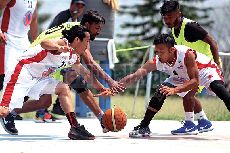 Bijay Burja (left) and Sadhish Pradhan of Times International Club vie for the ball against Mohamedul Hasan and Sandesh Tamang of Nepal Police Club during their Kwiks Nepal Basketball League match at Dhubarahi in Kathmandu on Tuesday. Photo: Udipt Singh Chhetry/ THT