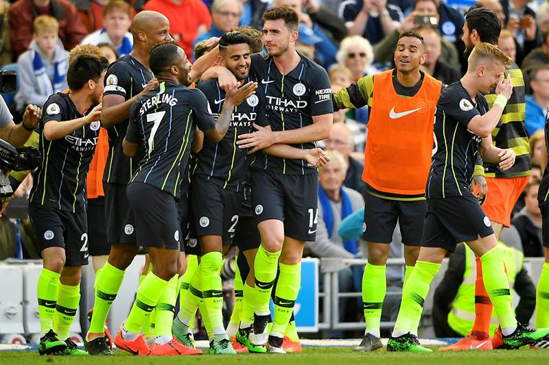 Manchester City's Riyad Mahrez celebrates scoring their third goal with team mates. Photo: Reuters