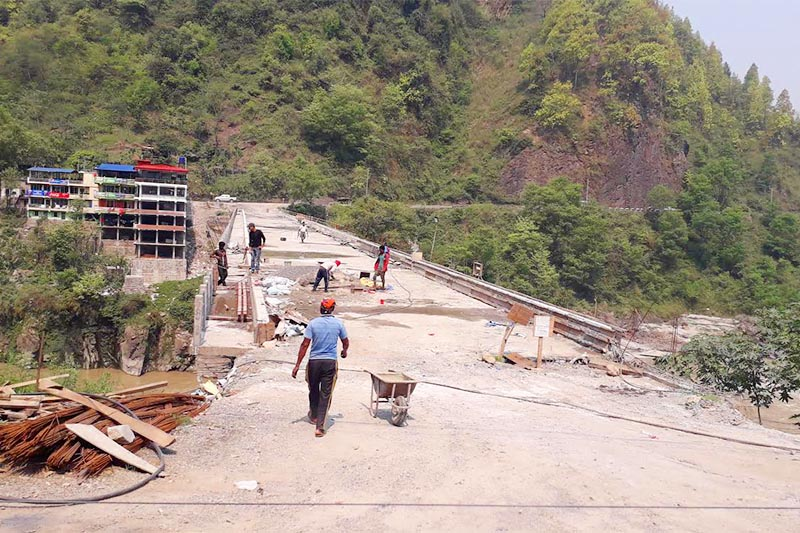 A view of the under-construction bridge over the Trishuli River in Mugling, Chitwan, on Wednesday, May 22, 2019. Photo: THT