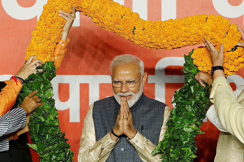 FILE PHOTO: Indian Prime Minister Narendra Modi gestures as he is presented with a garland by Bharatiya Janata Party (BJP) leaders after the election results in New Delhi, India, May 23, 2019. Photo: Reuters