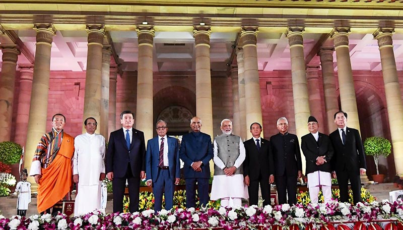 Indian Prime Minister Narendra Modi with leaders of BIMSTEC member nations, President of Kyrgyz Republic  SCO Chair and Pravasi Bharatiya PM of Mauritius, Prime Minister of Nepal KP Sharma Oli among others, after being sworn in as Prime Minister, in New Delhi, India, on Thursday, May 30, 2019. Photo: MEAIndia Twitter