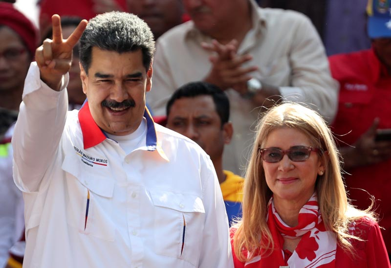 Venezuela's President Nicolas Maduro greets people next to his wife Cilia Flores during a rally in support of the government in Caracas, Venezuela May 20, 2019. Photo: Reuters