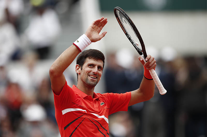 Serbia's Novak Djokovic celebrates after winning his second round match against Switzerland's Henri Laaksonen. Photo: Reuters