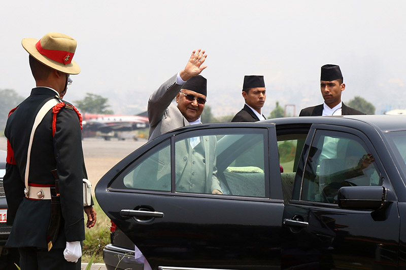 Prime Minister KP Sharma Oli gestures before leaving on an official visit to the Socialist Republic of Vietnam and the Kingdom of Cambodia, at Tribhuvan International Airport, in Kathmandu, on Thursday, May 9, 2019. Photo: RSS