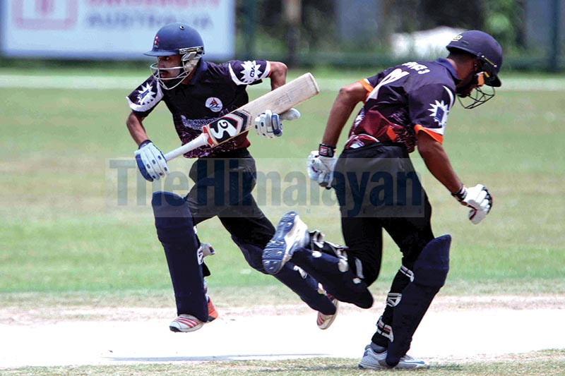 Ishan Pandey (left) and Adil Khan of Province-3 run between the wickets during their Expert Prime Minister Cup One Day Cricket Tournament match against Gandaki Province at the TU Stadium in Kathmandu on Tuesday. Photo: Udipt Singh Chhetry / THT