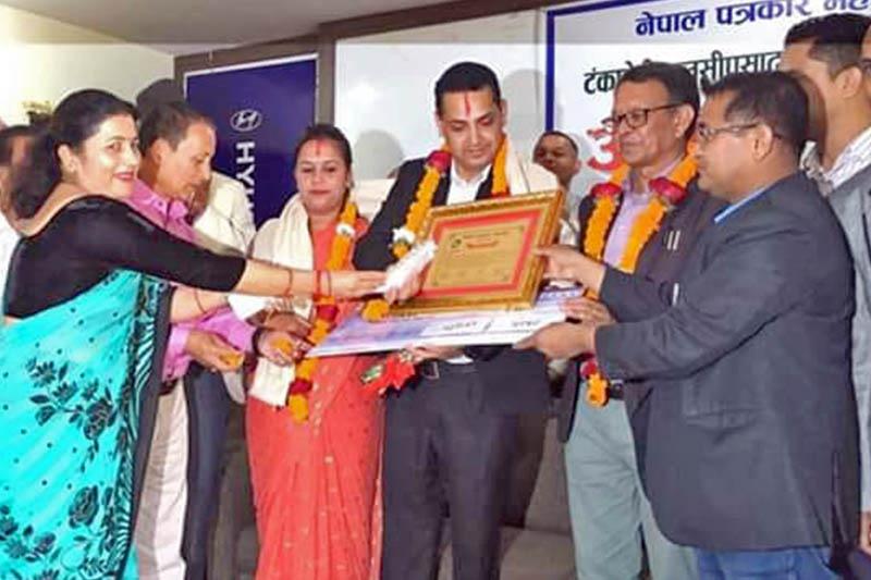 The Himalayan Times Pokhara reporter Rishi Ram Baral honoured in Pokhara, on Tuesday, May 07, 2019. Photo: Bharat Koirala/THT