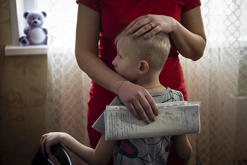 Natalya Konkova holds her son, Yaroslav, during an interview with The Associated Press in Moscow, Russia, on Monday, March 11, 2019. Photo: AP