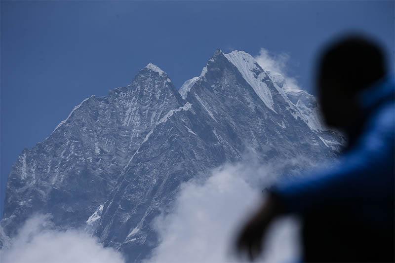 A person looks towards the Amadablam mountain in Solukhumbu district, on Tuesday, May 28, 2019. Photo: Skanda Gautam/THT