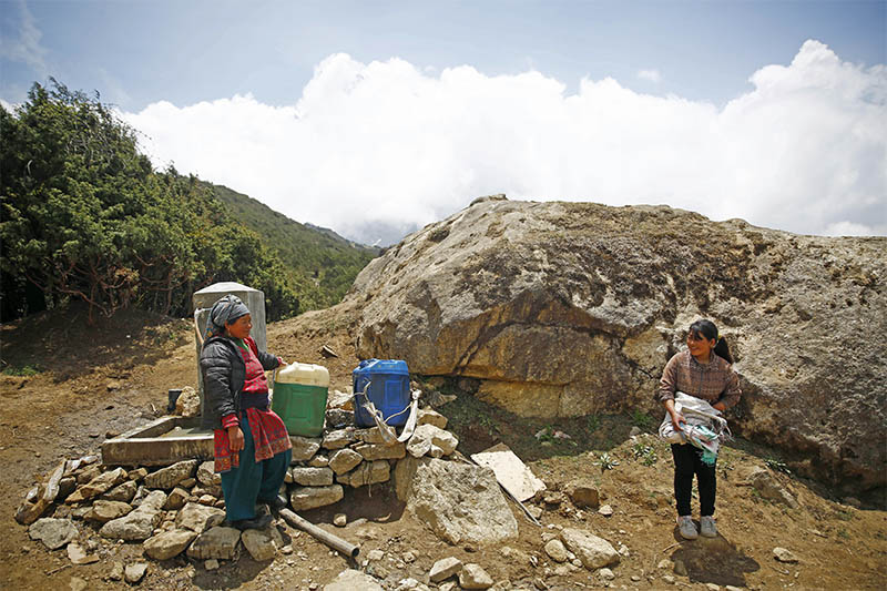 Local women chat as they collect water from a tap at Syangboche, in Solukhumbu district, on Tuesday, May 28, 2019. Photo: Skanda Gautam/THT