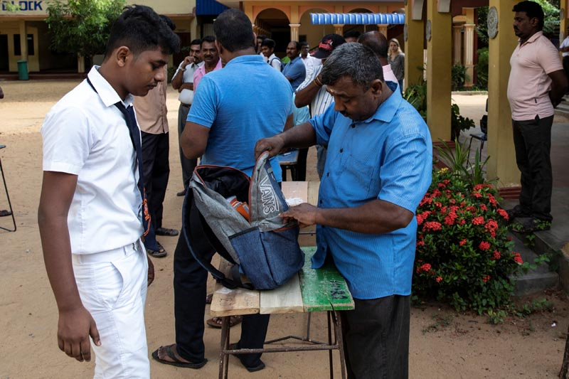 A student's bag is searched by a parent as he arrives at his school which opened days after a string of suicide bomb attacks across the island on Easter Sunday, in Batticaloa, Sri Lanka, May 6, 2019. Photo: Reuters