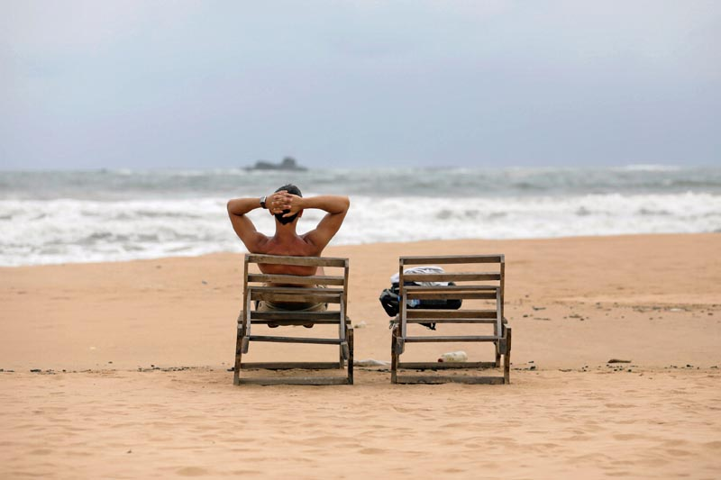 A tourist rests on a beach near hotels in a tourist area in Bentota, Sri Lanka May 2, 2019. Photo: Reuters