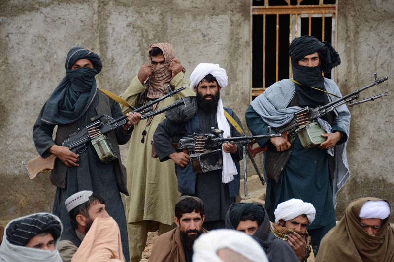 FILE: In this November 3, 2015 file photo, Afghan Taliban fighters listen to Mullah Mohammed Rasool, the newly-elected leader of a breakaway faction of the Taliban, in Farah province, Afghanistan. Photo: AP