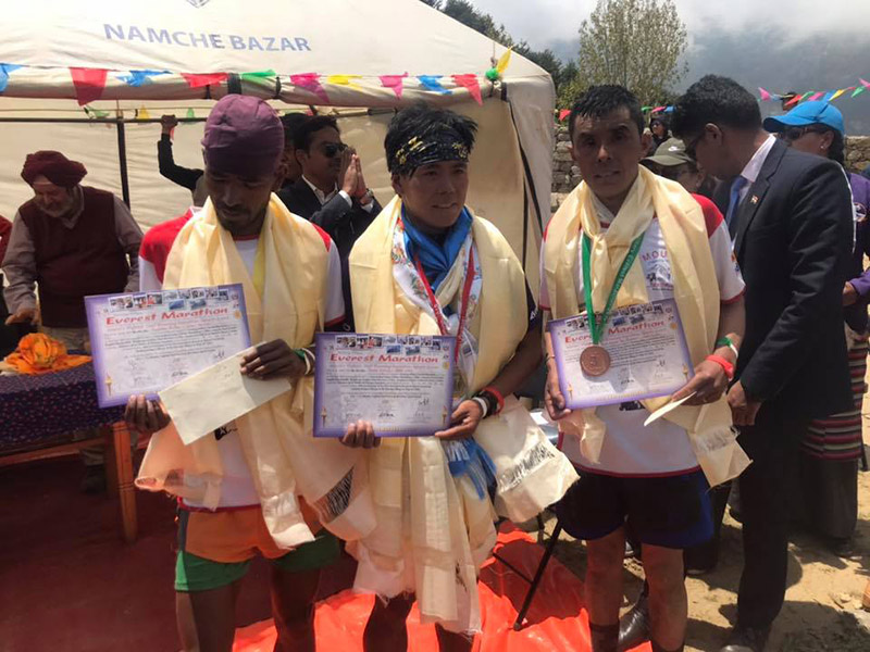 Winners of the Tenzing Hillary Everest Marathon 2019 pose with their certificates and medals on completion of this year's race in the Everest region, on Wednesday, May 29, 2019. Photo: Facebook/Tenzing Hillary Everest Marathon