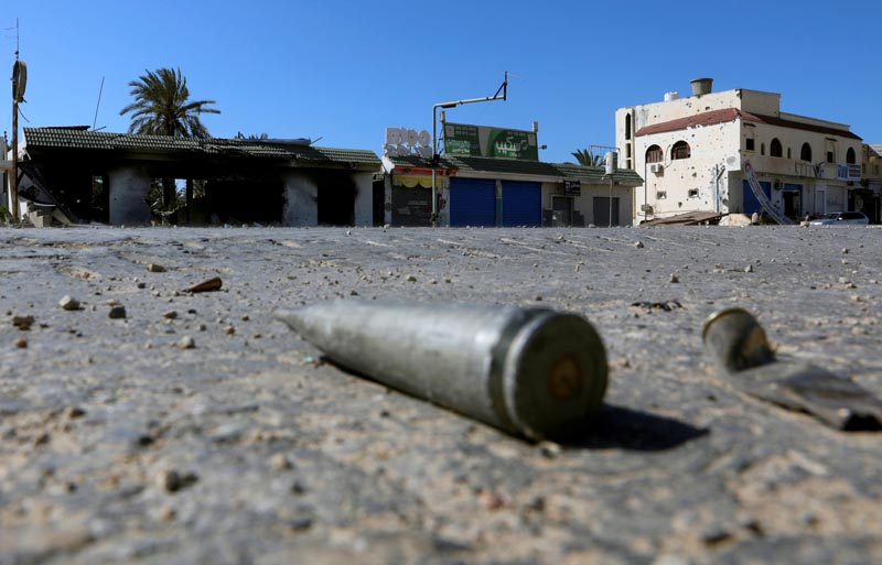 FILE: Shell casings are seen on the ground  during a fight between members of the Libyan internationally recognised government forces and Eastern forces in al-Yarmouk south of Tripoli, Libya May 7, 2019. Photo: Reuters/file