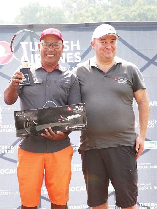 Babu Sherpa holds the trophy as General Manager of Turkish Airlines Abdullah Tuncer Kececi looks on after the Turkish Airlines World Golf Cup Kathmandu Qualifier at the Gokarna Golf Club on Saturday. Photo: THT