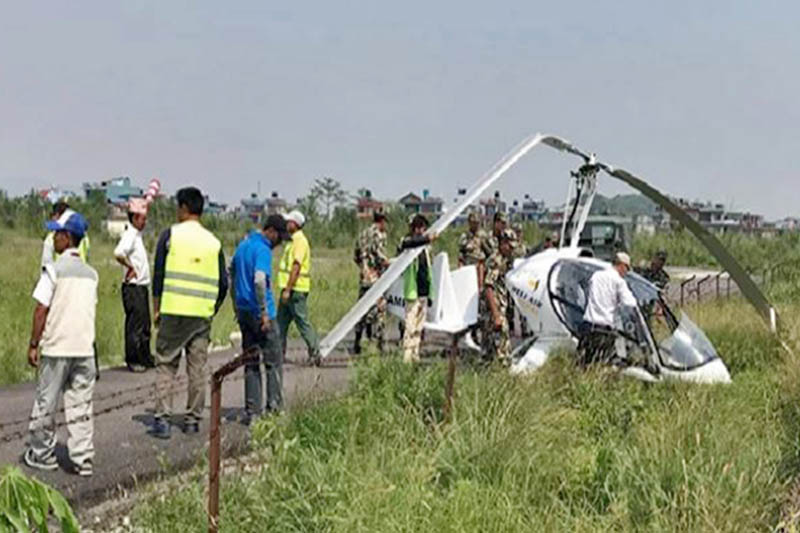 Nepal Army personnel and others are seen at the crash site in Pokhara airport on Tuesday, May 07, 2019. Photo: Bharat Koirala/THT