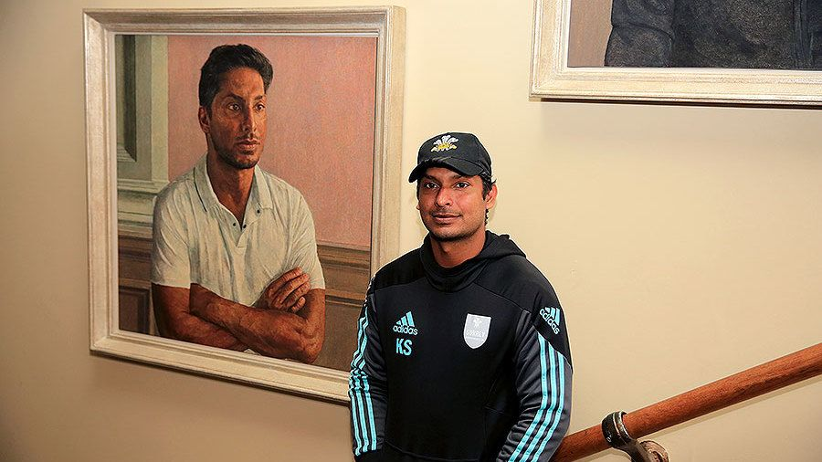 Kumar Sangakkara poses in front of his newly unveiled portrait in the Lord's Pavilion. Courtesy: Cricinfo.com