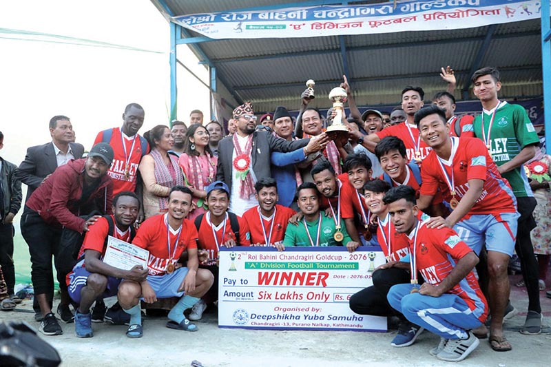 Chyasal Youth Club players and officials celebrate after winning the second Roj Bahini Chandragiri Gold Cup in Kathmandu on Sunday. Photo: THT