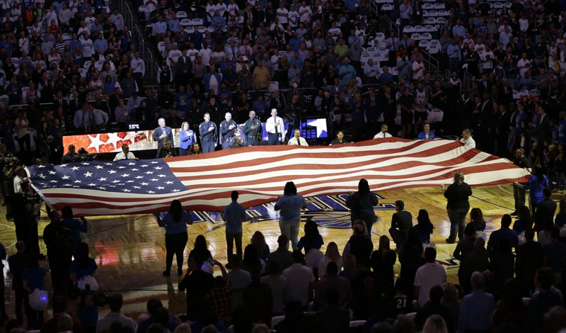 FILE: In this Wednesday, October 26, 2016 file photo, first responders hold a flag on the court as the national anthem is played during a tribute to the victims of the Pulse nightclub shooting prior to an NBA basketball game between the Orlando Magic and the Miami Heat in Orlando, Florida. Photo: AP/file.