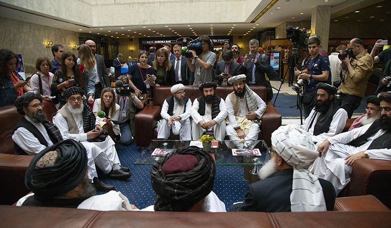 Mullah Abdul Ghani Baradar, the Taliban group's top political leader, left, Sher Mohammad Abbas Stanikzai, the Taliban's chief negotiator, second left, and other members of the Taliban delegation speak to reporters prior to their talks in Moscow, Russia on Tuesday, May 28, 2019. Photo: AP/File