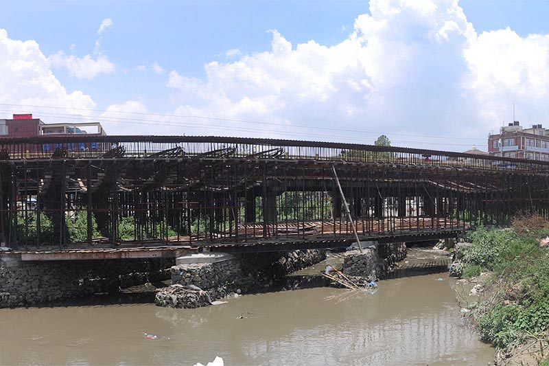 A general view of Bagmati Bridge that connects Subidhanagar and Shantinagar, in Tinkune, on Friday, June 14, 2019. The construction work of the bridge has been halted since long owing to quality discrepancies by the contractor u2014 Pappu Construction.Photo: Balkrishna Thapa Chhetri/THT