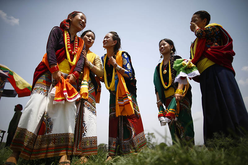 Nepalese women participate in Bhume Naach a ritual folk dance festival celebrated by the Kham Magar people from the mid-western part of Nepal in Kathmandu, Nepal on Sunday, June 16, 2019. On this day the people worship the land and nature for a better Earth by performing ritual folk dance. Photo: Skanda Gautam/THT