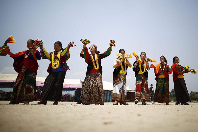 Nepalese women perform Bhume Naach a ritual folk dance festival celebrated by the Kham Magar people from the mid-western part of Nepal in Kathmandu, Nepal on Sunday, June 16, 2019. On this day the people worship the land and nature for a better Earth by performing ritual folk dance. Photo: Skanda Gautam/THT