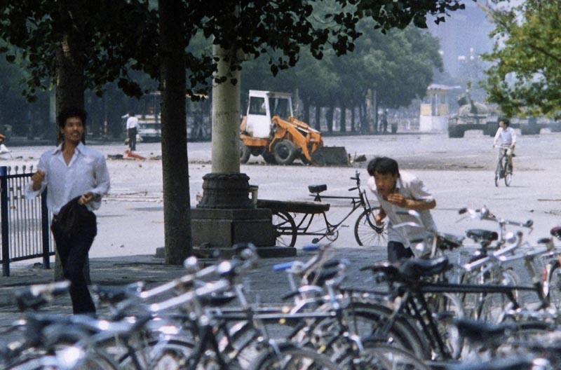 FILE: In this June 5, 1989, file photo, three unidentified men flee the scene, as a Chinese man, background left, stands alone to block a line of approaching tanks, background right, in Beijing's Tiananmen Square. Photo: AP/file