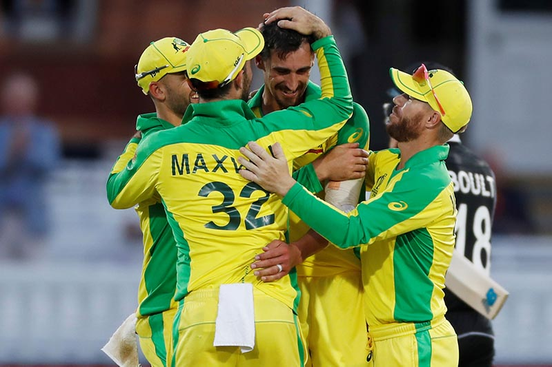 Australia's Mitchell Starc celebrates winning the match by taking the wicket of New Zealand's Mitchell Santner with team mates during the ICC Cricket World Cup match  between New Zealand and Australia, at  Lord's, in London, Britain, on June 29, 2019. Photo: Action Images via Reuters