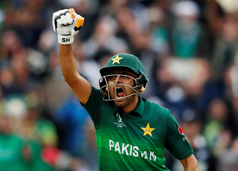Pakistan's Babar Azam celebrates a century during the ICC Cricket World Cup match between New Zealand and Pakistan, at Edgbaston, in Birmingham, Britian, on June 26, 2019. Photo: Action Images via Reuters