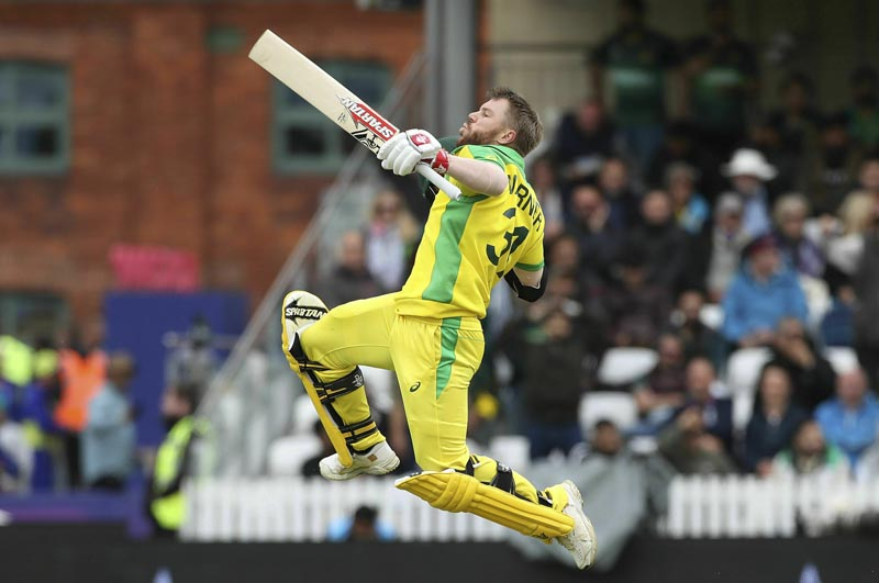 Australia's David Warner celebrates his century during the Cricket World Cup group stage match against Pakistan at the County Ground Taunton, England, Wednesday June 12, 2019. Photo: David Davies/PA via AP