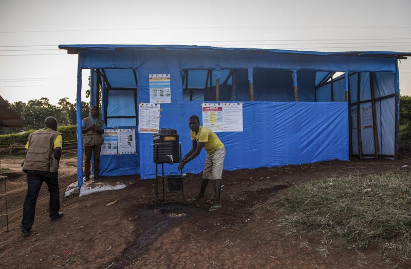 This photo released by the International Rescue Committee (IRC) shows a Congolese refugee boy washing his hands before entering one of the medical tents used for evaluating newly arrived Congolese for potential symptoms of Ebola, at the Kyaka refugee settlement in western Uganda Wednesday, June 12, 2019. Photo: AP