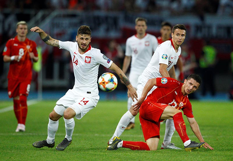 Poland's Mateusz Klich and Przemyslaw Frankowski in action with North Macedonia's Enis Bardhi during the Euro 2020 Qualifier Group G match between North Macedonia and Poland, at Tose Proeski Arena, in Skopje, North Macedonia, on June 7, 2019. Photo: Reuters