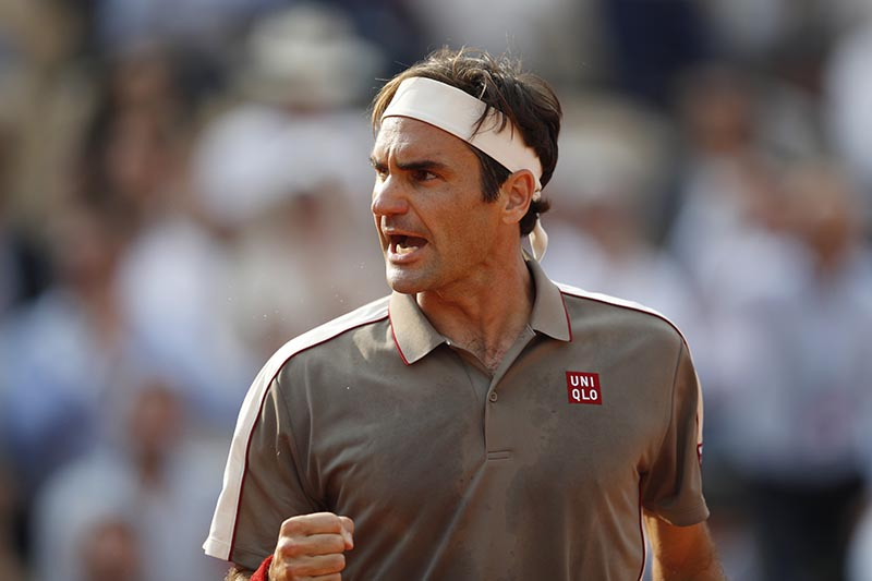Switzerland's Roger Federer reacts during his quarterfinal match against Switzerland's Stanislas Wawrinka during the French Open, at Roland Garros, in Paris, France, on June 4, 2019. Photo: Reuters