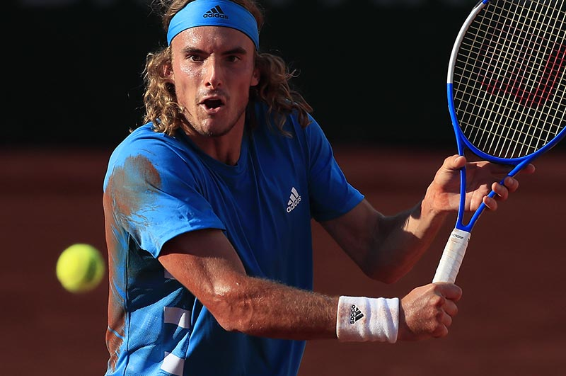 Greece's Stefanos Tsitsipas in action during his fourth round match against Switzerland's Stan Wawrinka during the French Open, at Roland Garros,in  Paris, France, on June 2, 2019. Photo: Reuters