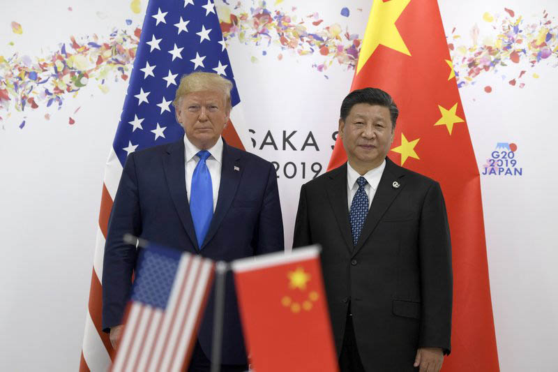 President Donald Trump (left) poses for a photo with Chinese President Xi Jinping during a meeting on the sidelines of the G-20 summit in Osaka, Japan, Saturday, June 29, 2019.