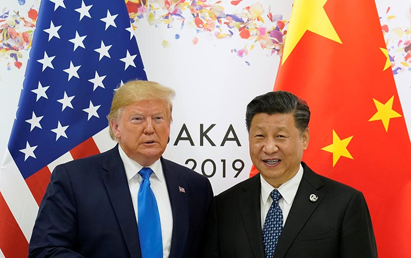 US President Donald Trump and China's President Xi Jinping poses for a photo ahead of their bilateral meeting during the G20 leaders summit in Osaka, Japan, June 29, 2019. Photo: Reuters