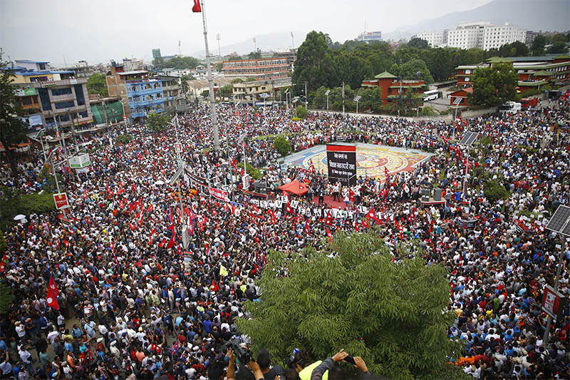 Thousands of people attend a mass gathering to protest against the controversial Guthi Bill, at Maitighar Mandala, in Kathmandu, on Wednesday, June 19, 2019. Photo: Skanda Gautam/THT