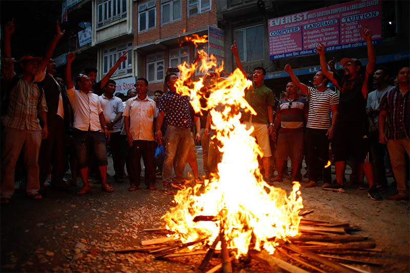 Members of the indigenous Newar community take part in a torch protest against the controversial Guthi Bill after the government decided to withdraw the bill, in Kathmandu, on Tuesday, June 18, 2019. Photo: Skanda Gautam/THT