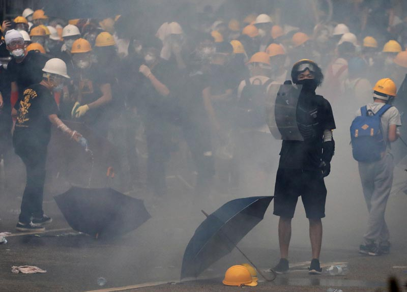 A protester holds a shield during a demonstration against a proposed extradition bill in Hong Kong, China June 12, 2019. Photo: Reuters