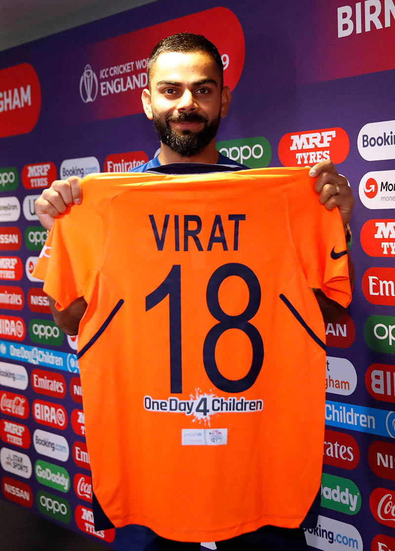 India's Virat Kohli poses with his shirt during a press conference during the ICC Cricket World Cup during the India Press Conference, at Edgbaston, in Birmingham, Britain, on June 29, 2019. Photo: Action Images via Reuters